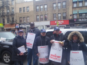 Tara Pappas of UFCW Local 342 (far left), with workers from Trade Fair meat department including Eunice Izquierdo (second from right) and Beatriz Gomez (far right)