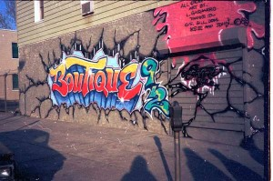 """Boutique 92"" - one of Louie's Astoria murals from 1988: 38th Street and Broadway."